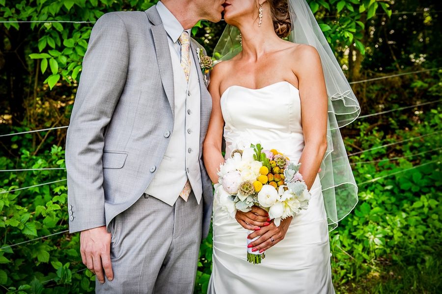 bride and groom kiss during their red wing, mn wedding at memorial park