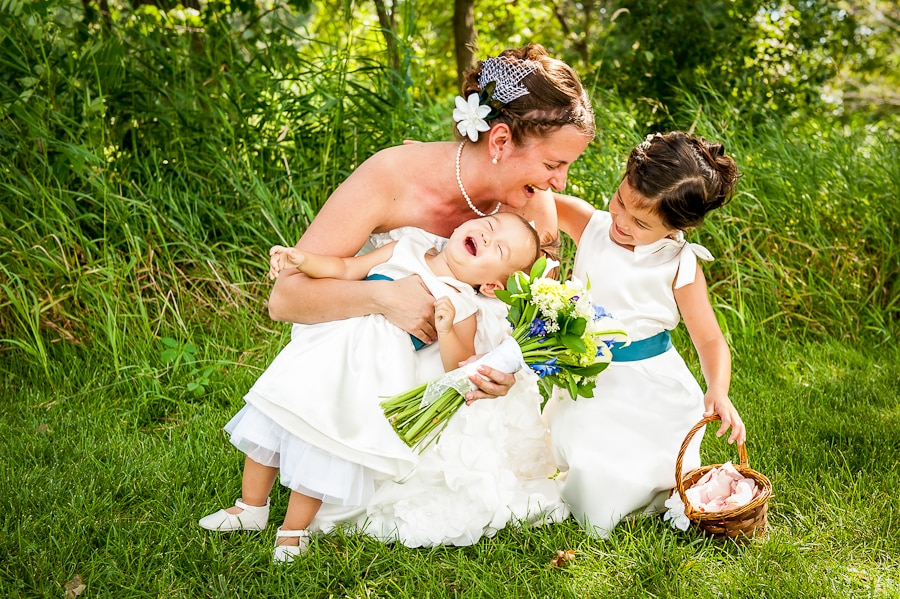 Touching moment full of emotion as the bride embraces and shares a beautiful moment with her young flower girls