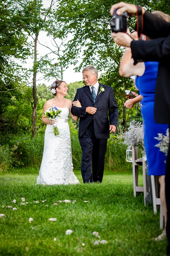 Father walks his daughter down the isle on her wedding day