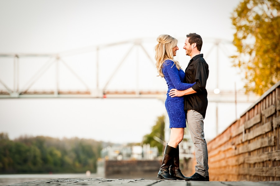 Couple embraces on the dock at Levee Park in Red Wing, MN during their engagement session