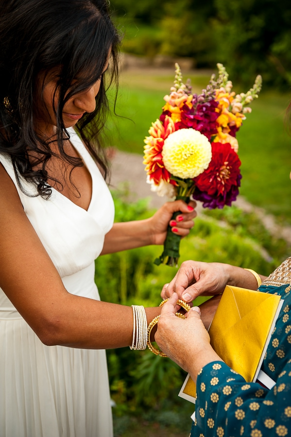 traditional Indian gift exchange after the wedding ceremony with mother gifting a bracelet to her daughter