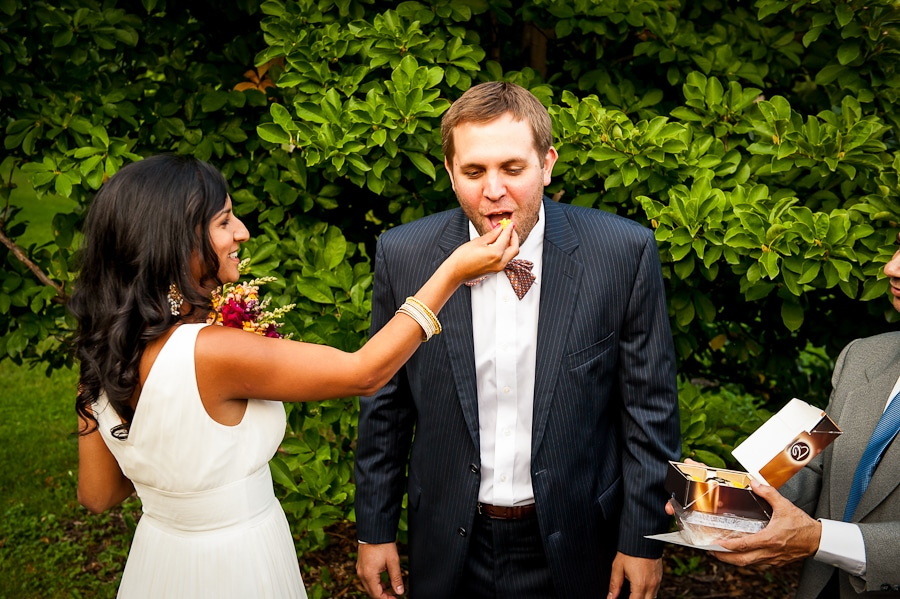 bride feeds her groom after the ceremony which is a tradition in Indian wedding culture.