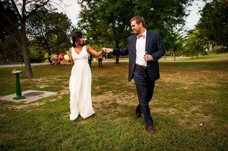 Bride and groom giving each there knuckles on their wedding day at Lyndale Park
