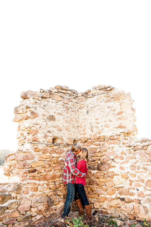 Couple sharing a kiss among the crumbled ruins of the Historic 1880 Jabs Farmstead at Louisville Swamp