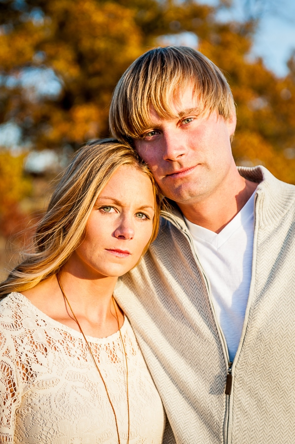 Close up portrait of couple looking serious but happy during their Louisville Swamp engagement photos