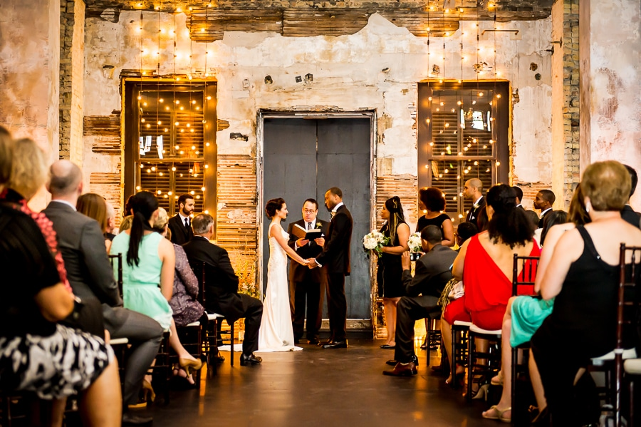 Bride and groom exchange vows during their Minneapolis Wedding at Aria