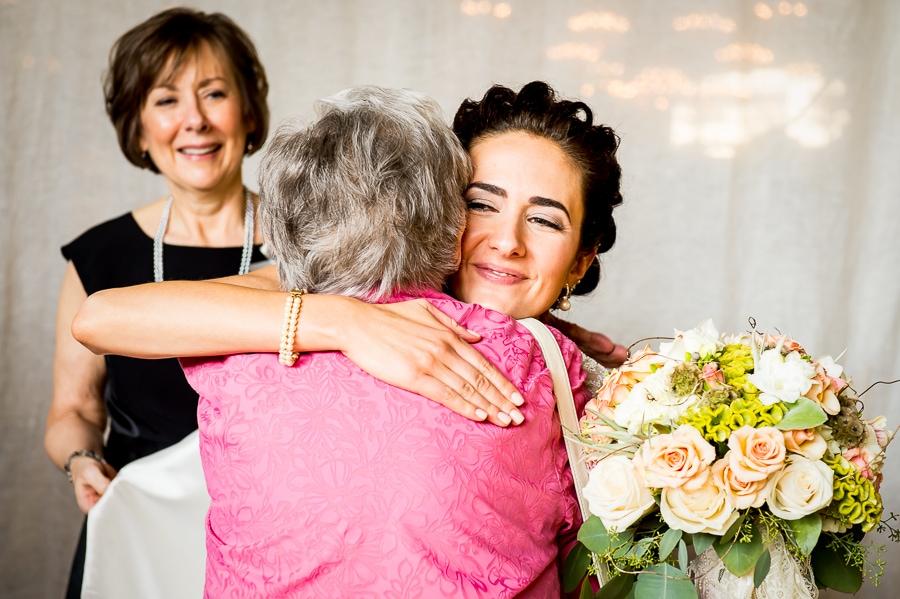 Bride hugs her grandmother backstage at Aria