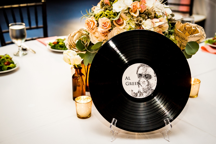 close up of centerpiece record featuring Al Green during this fun music-themed wedding at Aria
