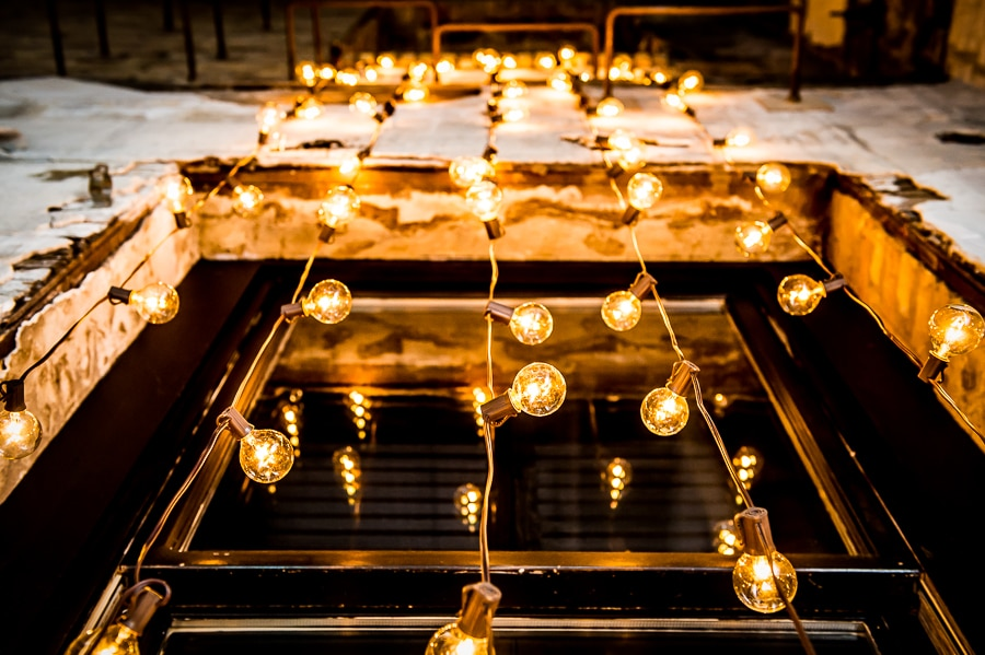 long string lights in the wedding ceremony area