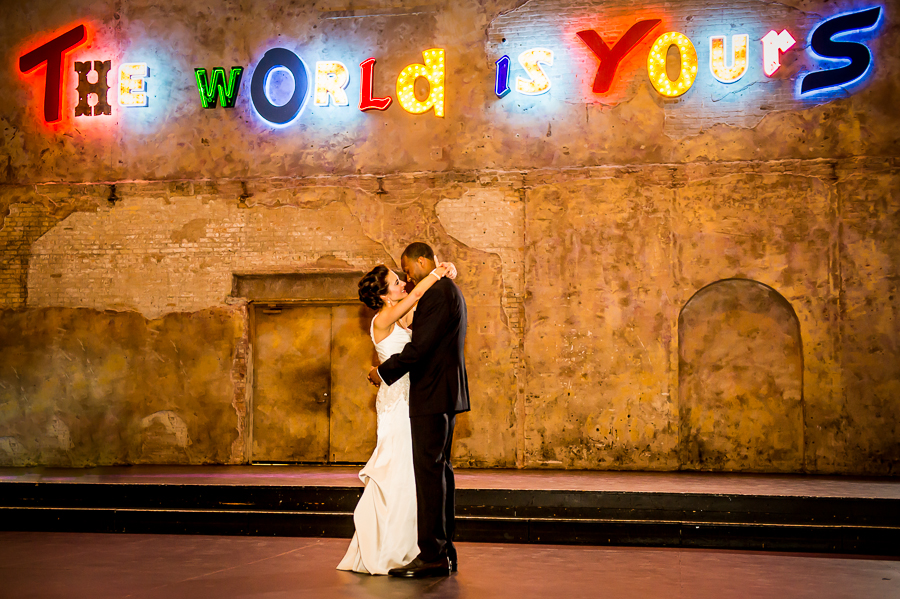 """Wide angle view of first dance under the """"The World is Yours"""" sign at Aria"""