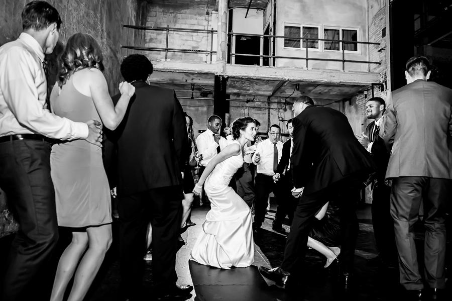 Bride and groom boogie down low on the dance floor