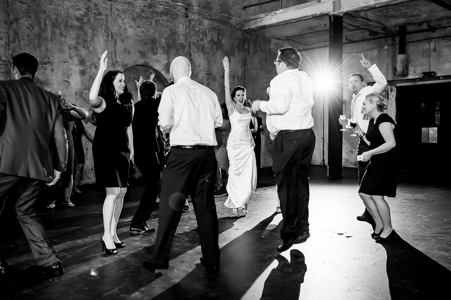 Bride gets airborne on the dance floor during her Minneapolis wedding at Aria