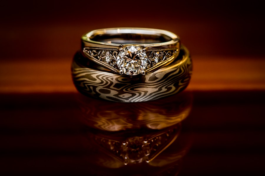detail shot of the bride and grooms wedding rings at the Weisman Art Museum