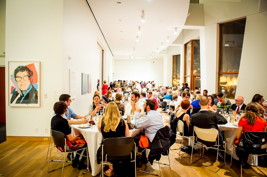 Wedding reception space inside the Weisman Art Museum, with all the guests seated at their tables