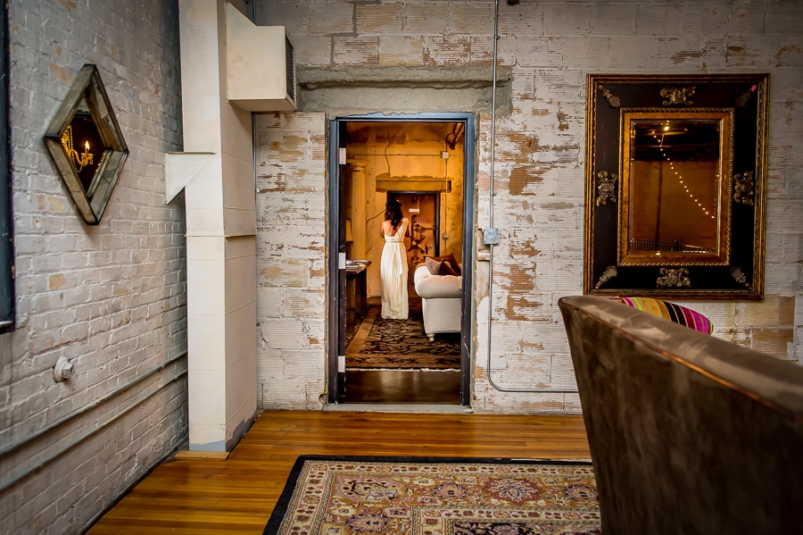 Bride framed in the doorway right before her first look moment