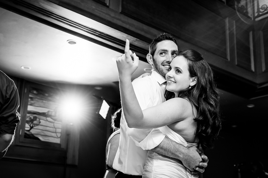 Bride and groom encourage others to join them on the dance floor
