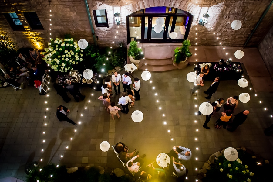Outdoor wedding reception space at night, with string lights, at the Van Dusen Mansion