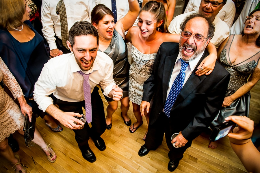 Groom and his uncle sing out loudly on the dance floor