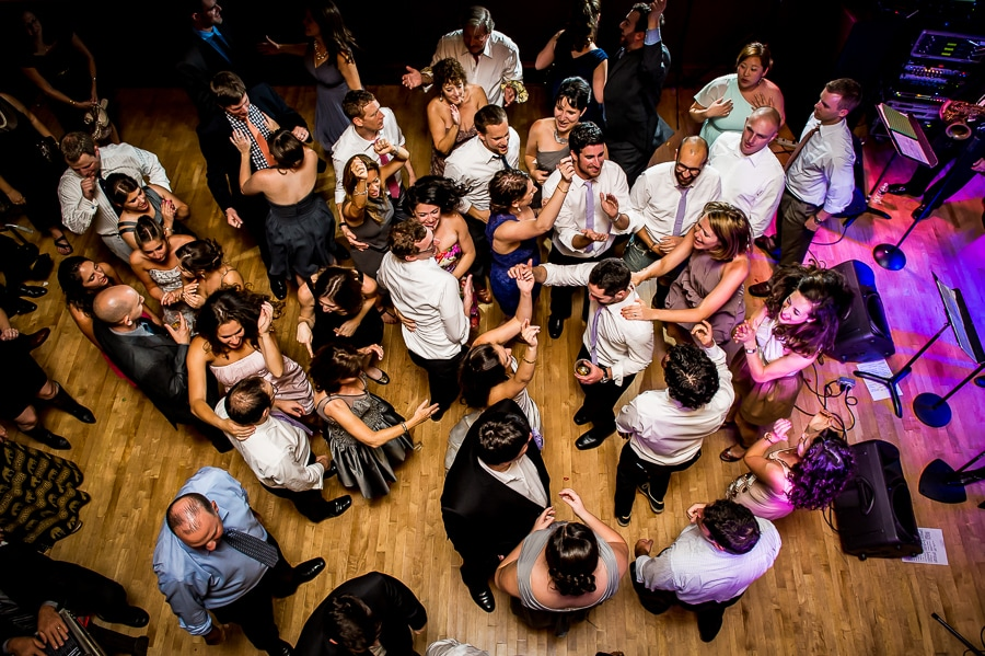 Overheard shot from the balcony of the jam packed wedding dance floor at the Van Dusen Mansion
