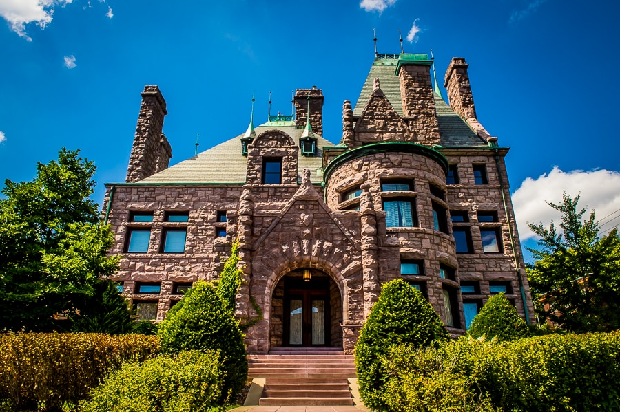 Exterior shot of the Van Dusen Mansion with a brilliant blue sky on a perfect summer wedding day