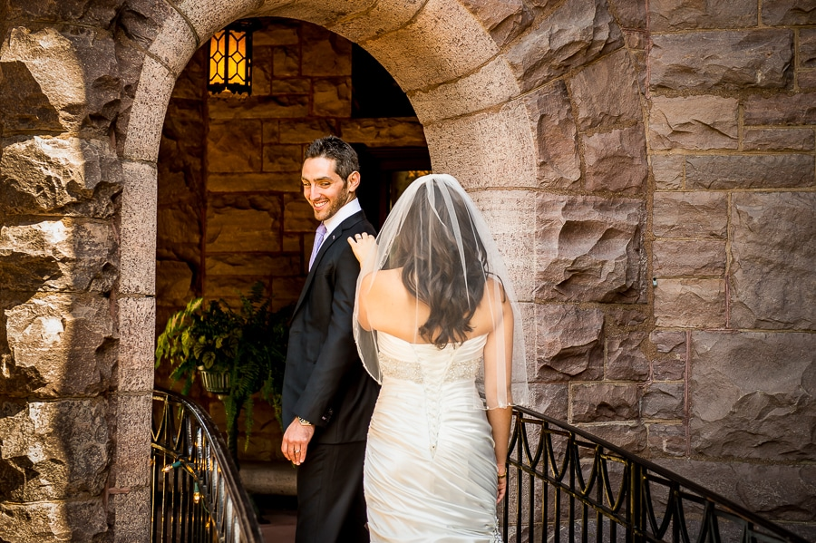 Close up shot of the first look between the bride & groom outside of the Van Dusen Mansion