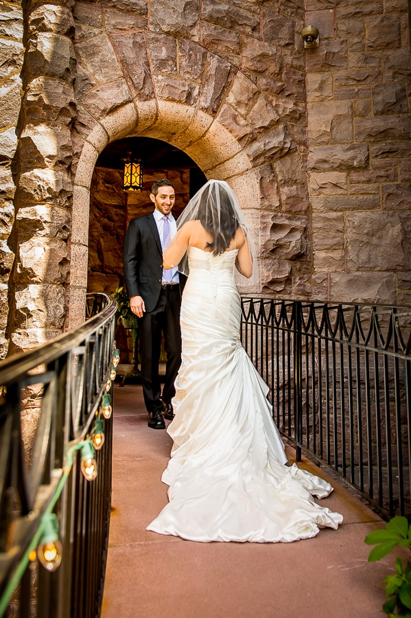 Groom being struck with awe of his brides beauty on their wedding day at the Van Dusen Mansion