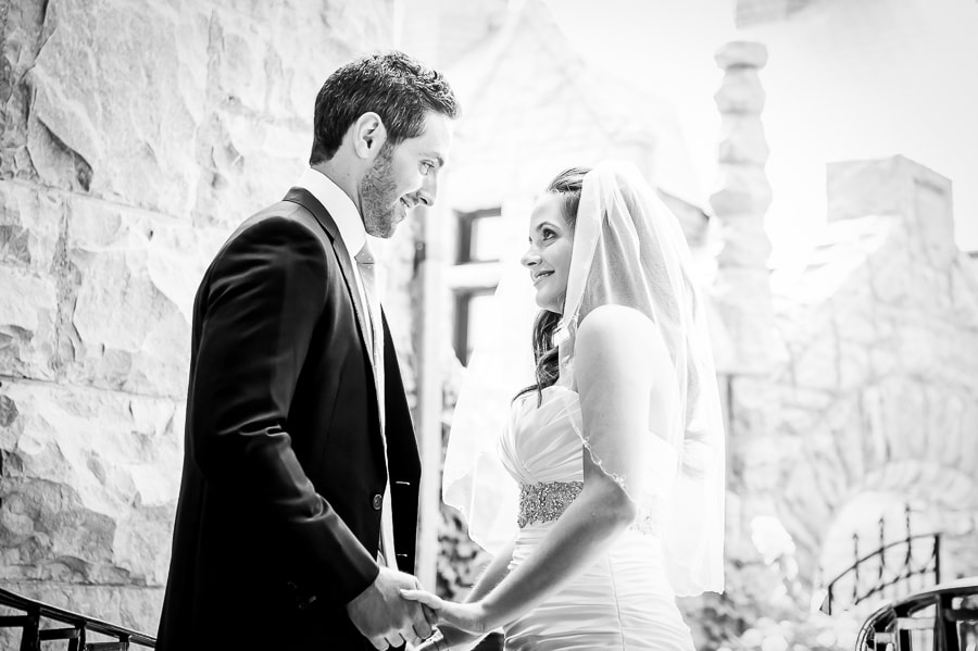 black and white images of bride and groom sharing a tender moment during their first look at the Van Dusen Mansion