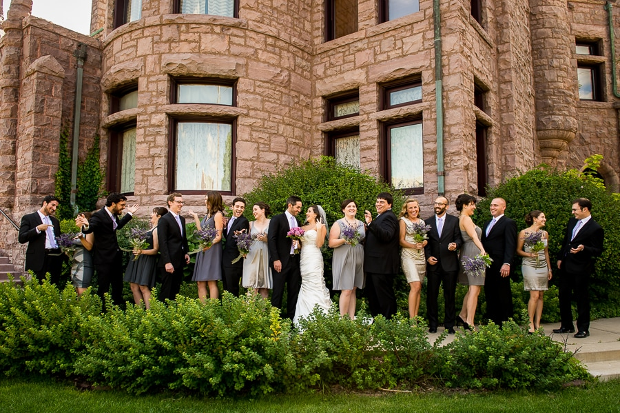 Wedding party laughs it up outside of the Van Dusen Mansion