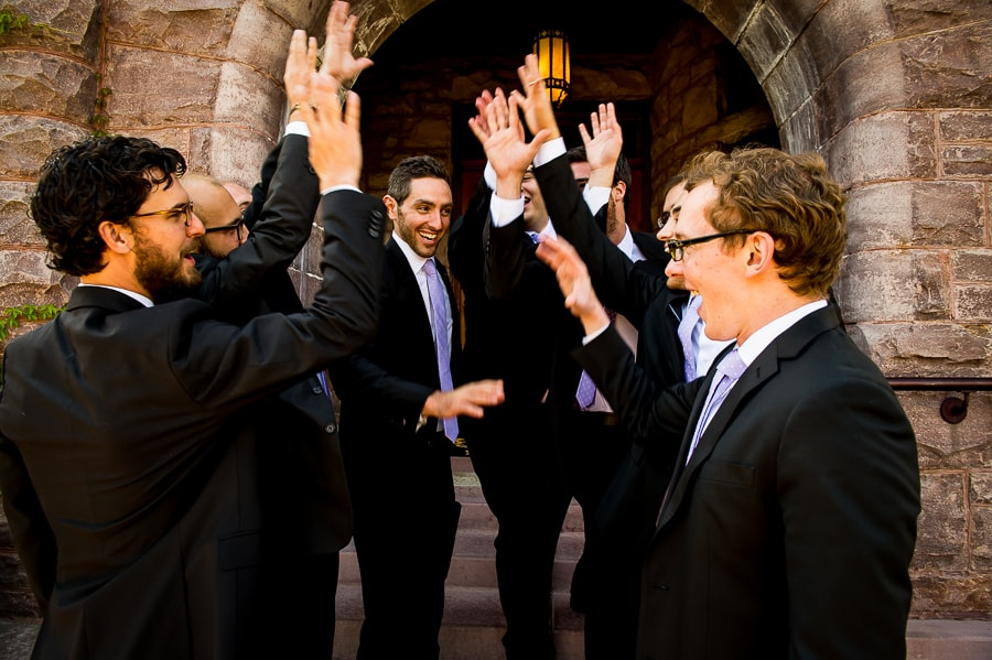 Groomsmen and groom break it down in front of the Van Dusen Mansion