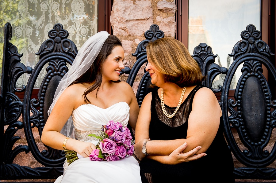 Bride and her mother share a sweet moment before she is married, outside of the Van Dusen Mansion