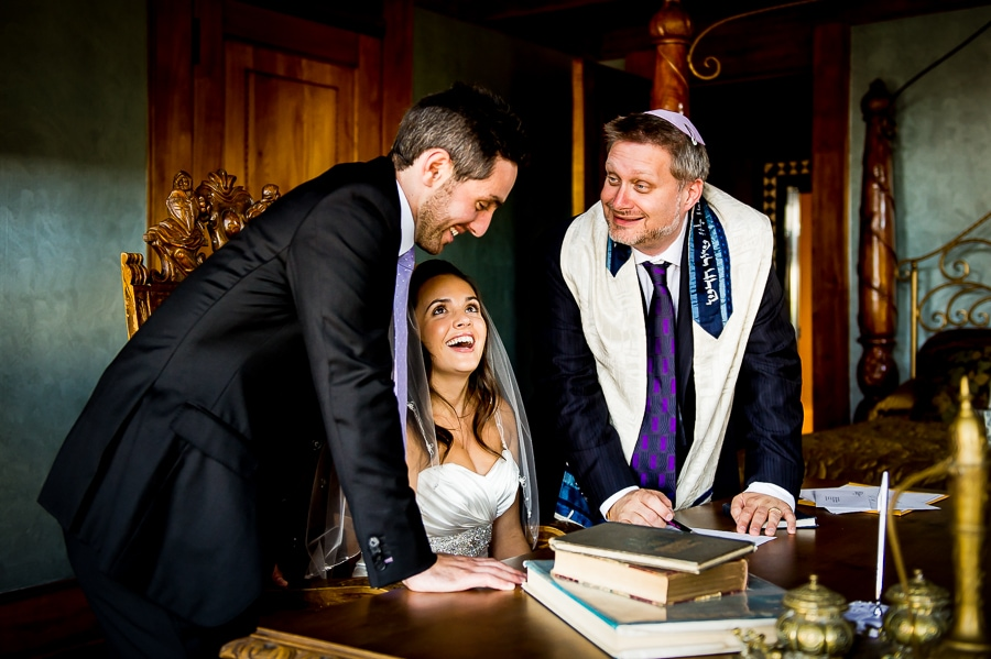 Funny moment with bride, groom, and Rabbi during their Ketubah signing at the Van Dusen Mansion