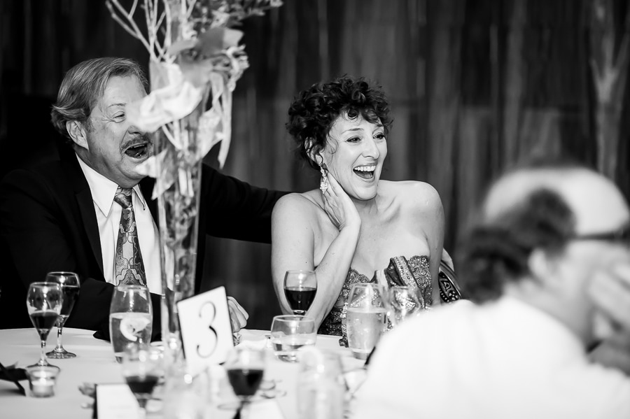 Mother of the bride laughs out loud during the speeches