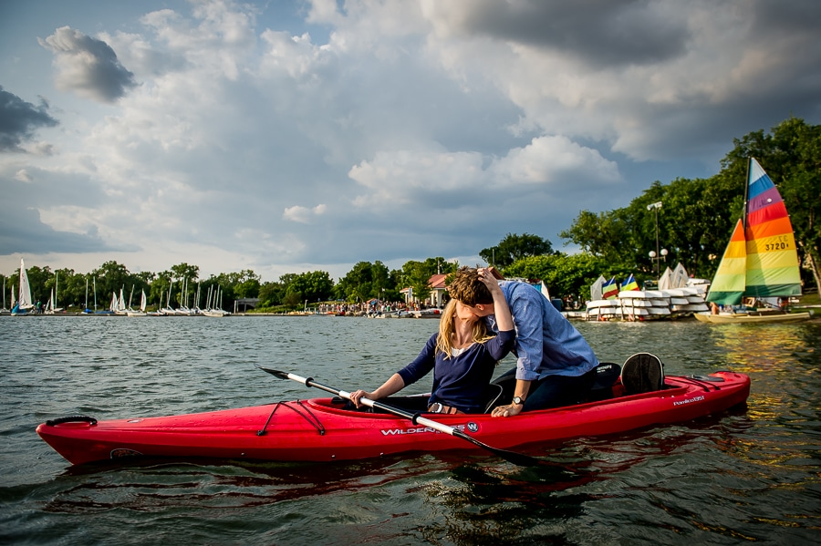 Bde Maka Ska, aka Lake Calhoun, Engagement photo with couple kissing on a colorful kayak