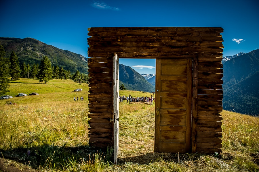 Handmade wooden door entrance to the wedding ceremony site overlooking Wallowa Lake in Joseph, OR
