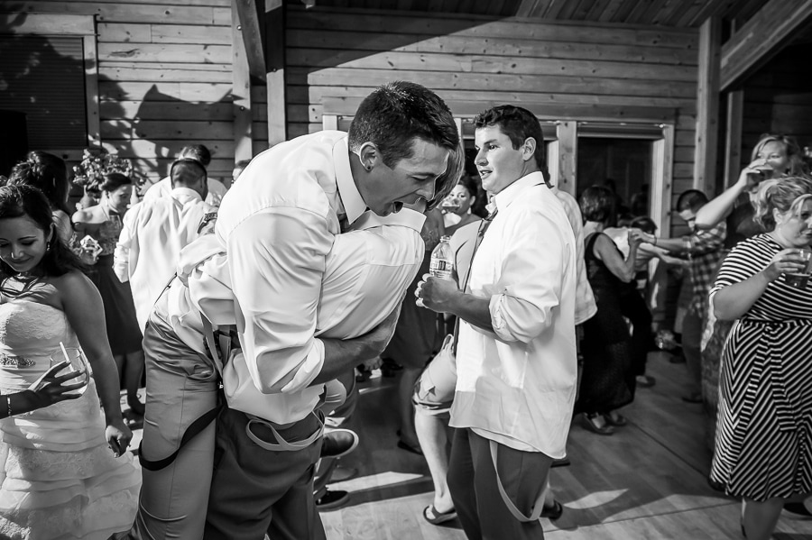 Groomsen lifts the groom up in the air during the wedding reception dance at the Josephy Center for Arts and Culture