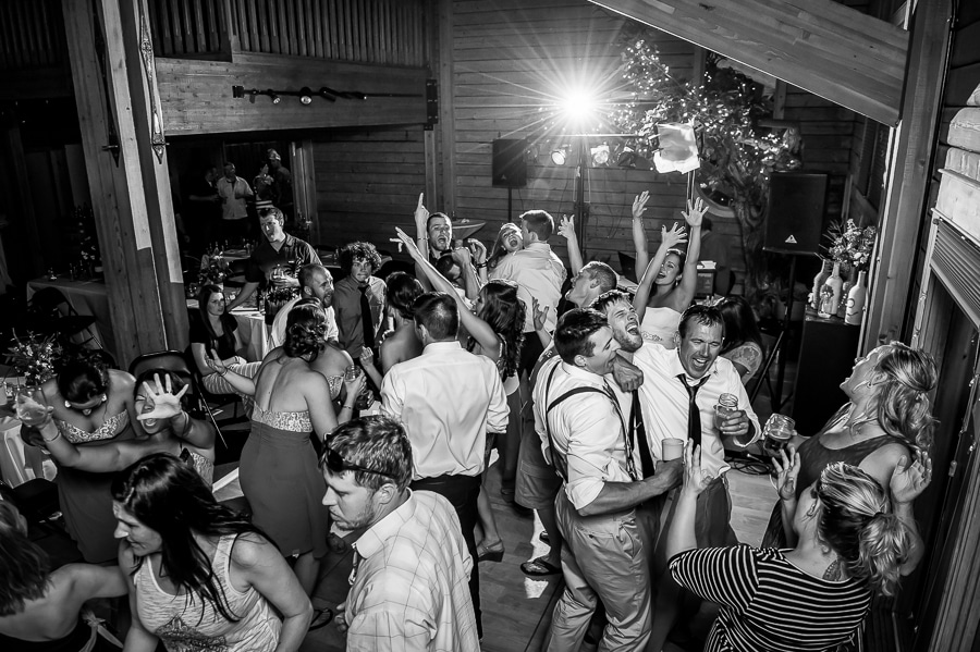 A packed dance floor during the wedding reception at the Josephy Center for Arts and Culture with everyone singing at the top of their lungs