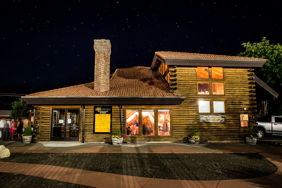 Night time photo of the starry sky sitting over the Josephy Center for Arts and Culture during the wedding reception in this cool log cabin style Joseph, OR wedding venue
