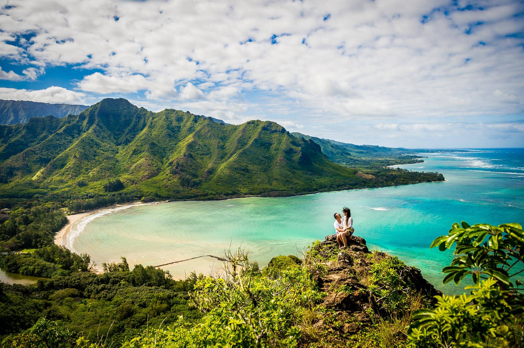 Hawaii engagement photo of couple on mountain top overlooking the ocean