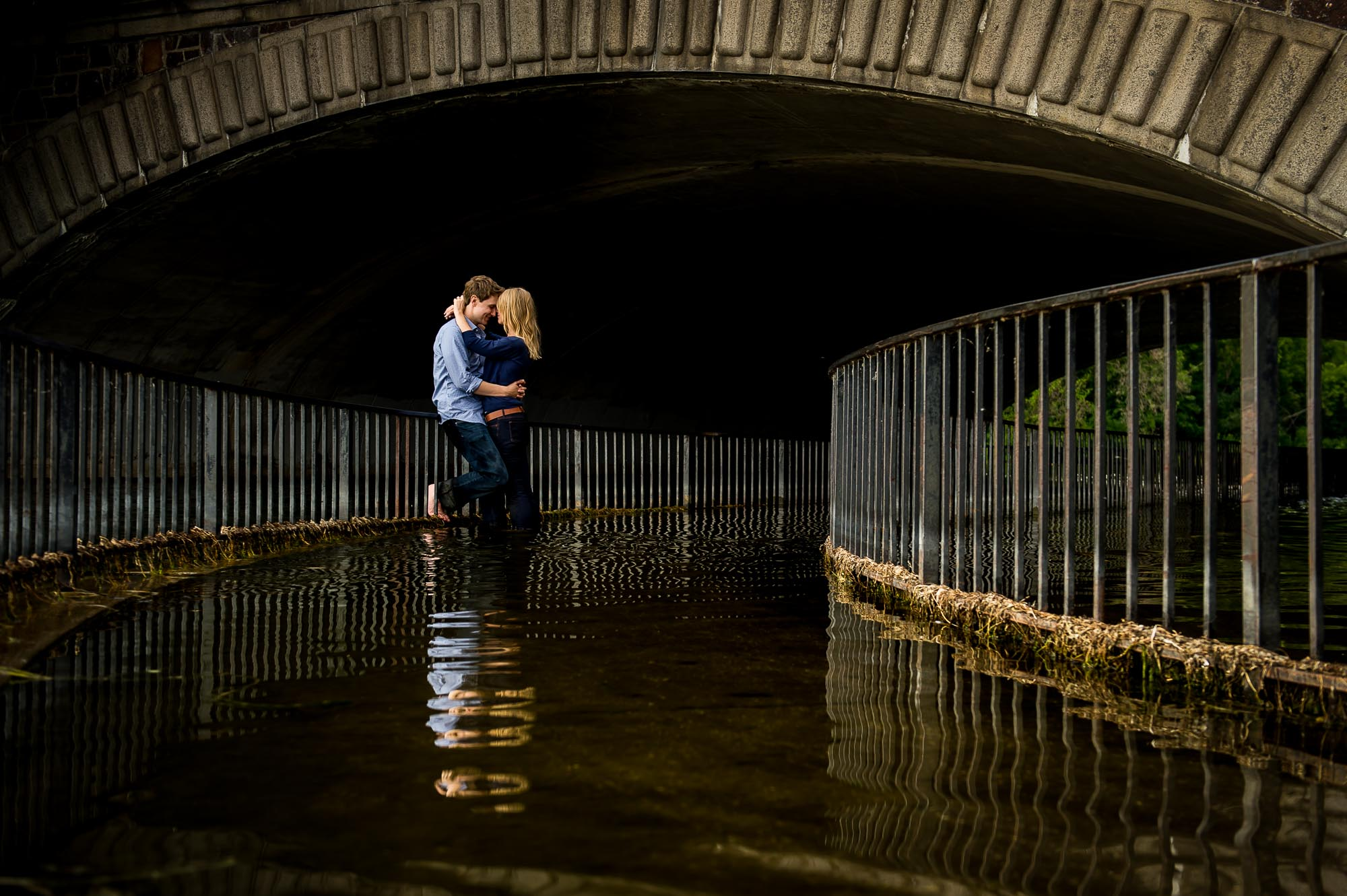 Lake Calhoun engagement photo with water and bridge in background