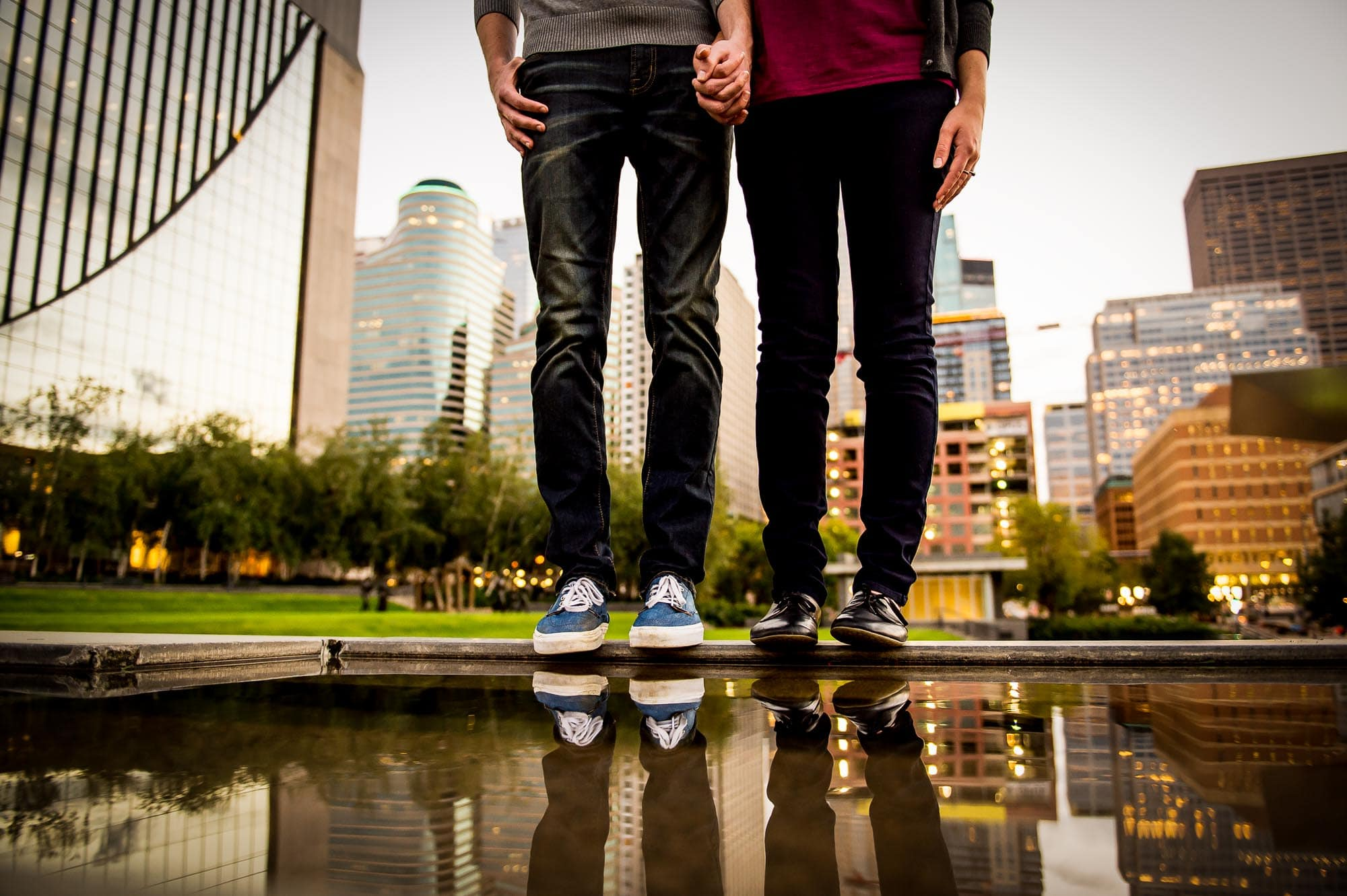 artistic photo of engaged couples reflection over the water fountain in downtown Minneapolis
