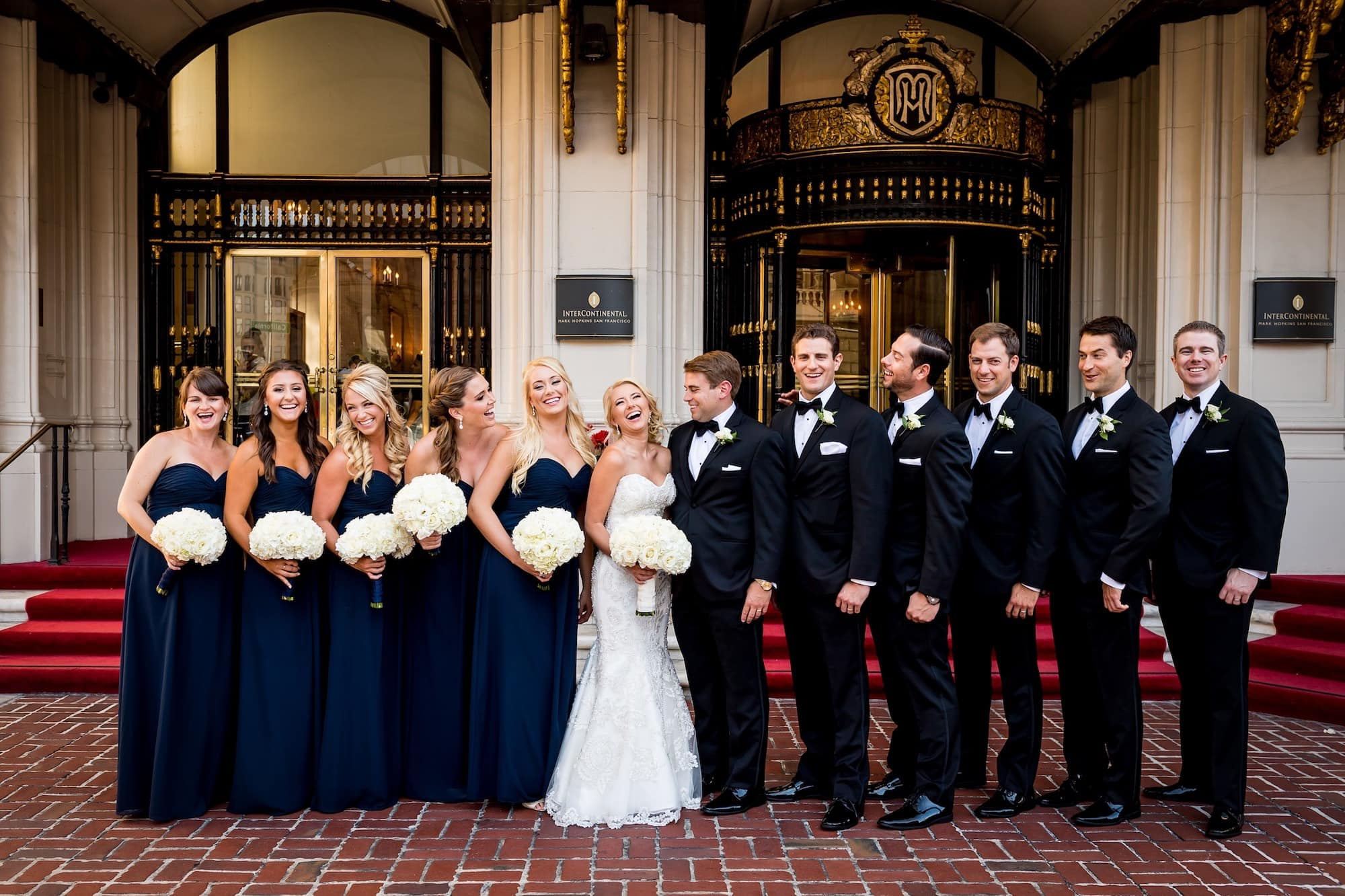bridal party in front of mark hopkins hotel
