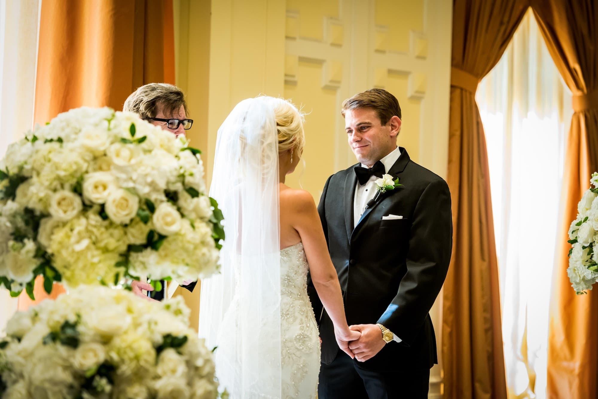 groom looking at bride in ceremony