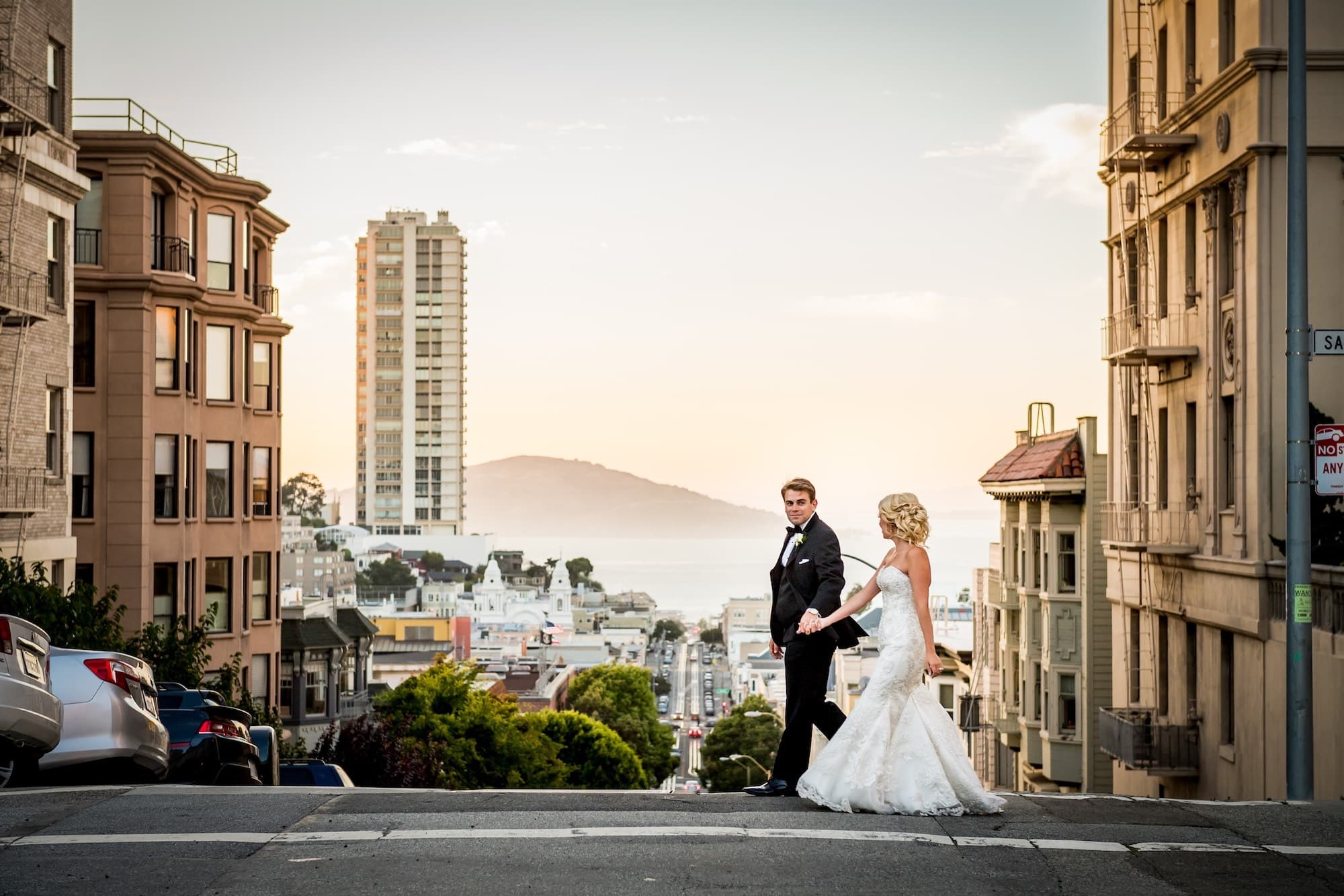 bride and groom walking san francisco