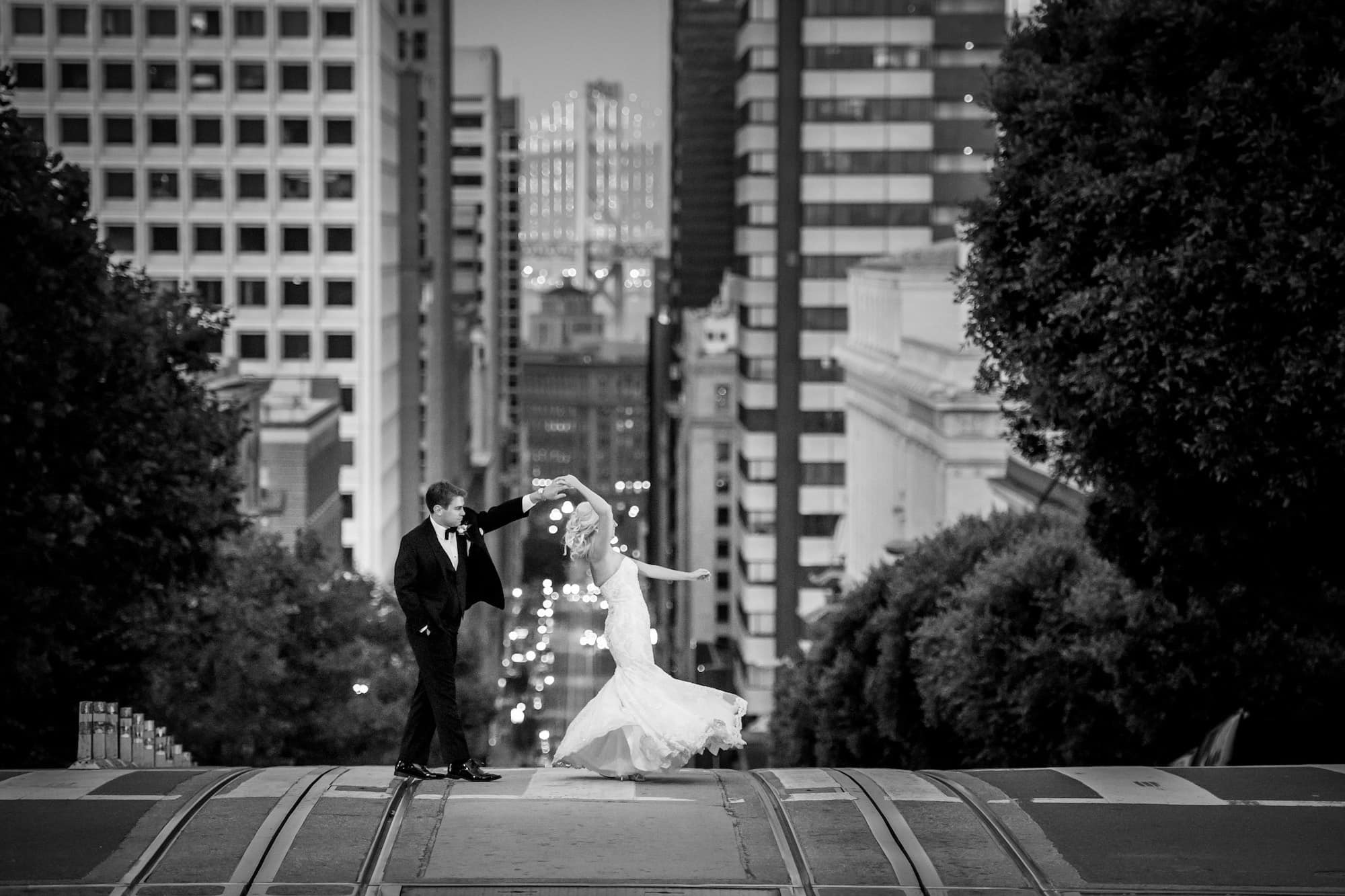 bride and groom dancing san francisco street