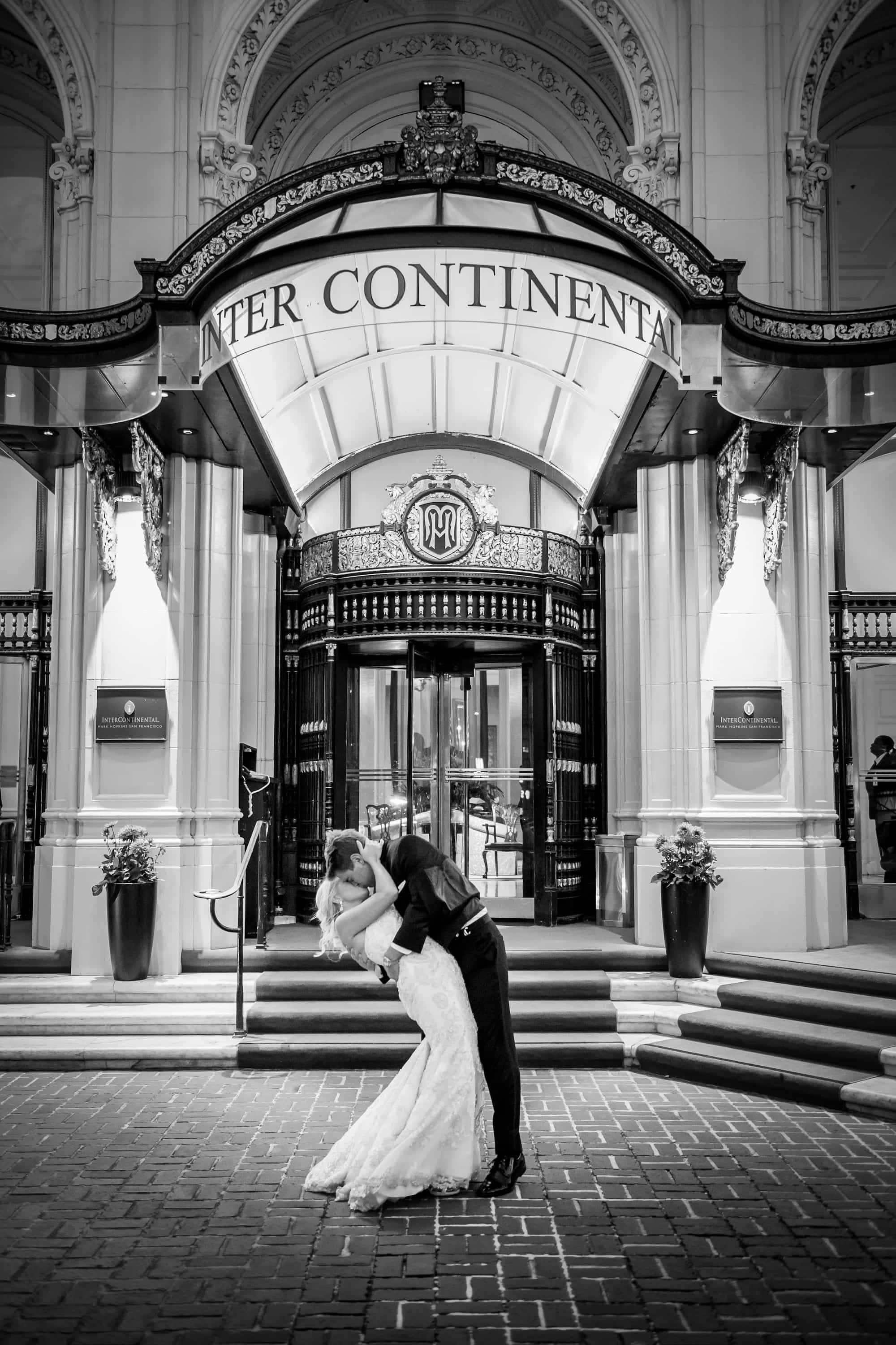 bride and groom in front of mark hopkins hotel