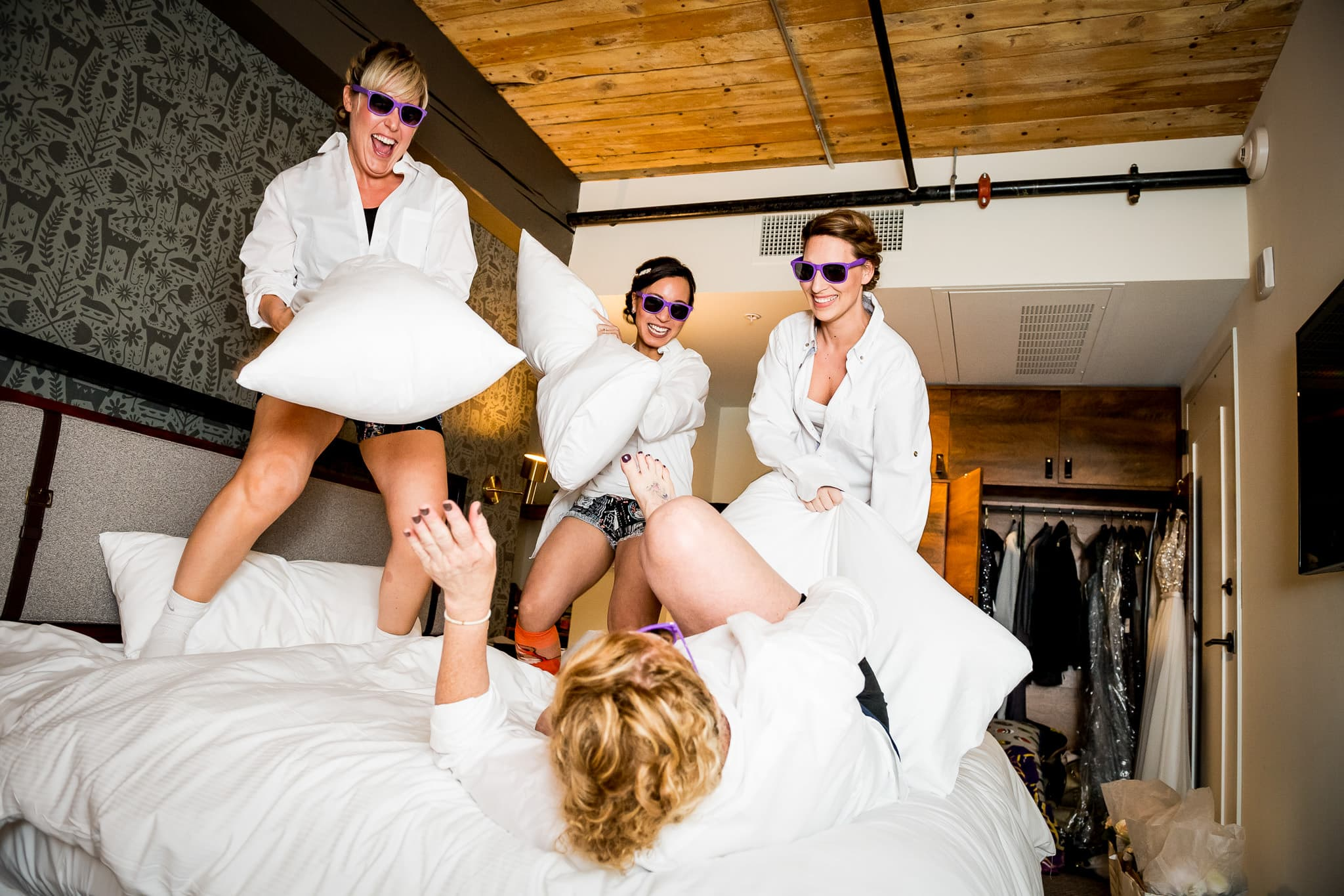 Bridesmaids pillow fight at the Hewing Hotel