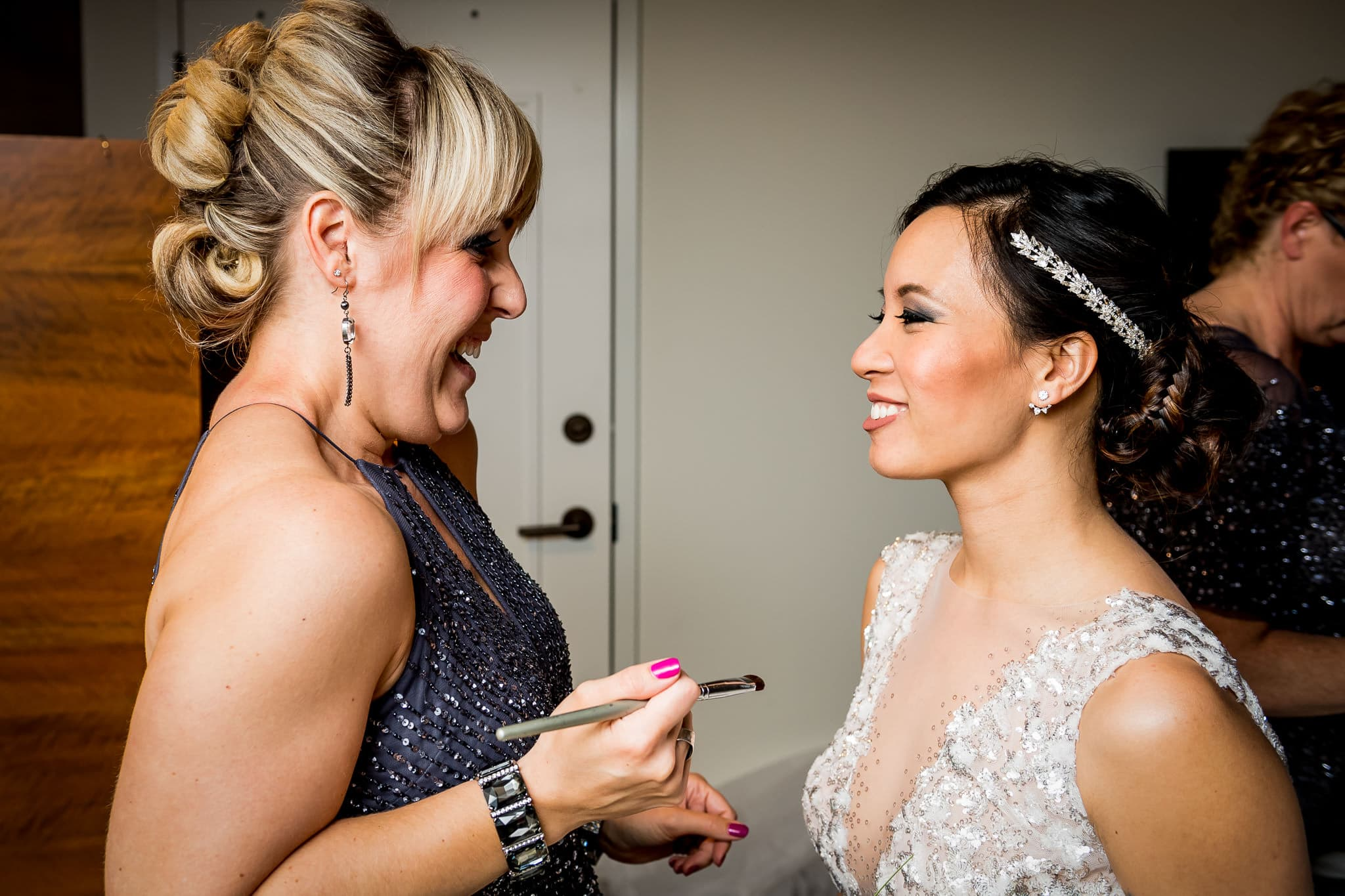 Bride getting her makeup done at the Hewing Hotel