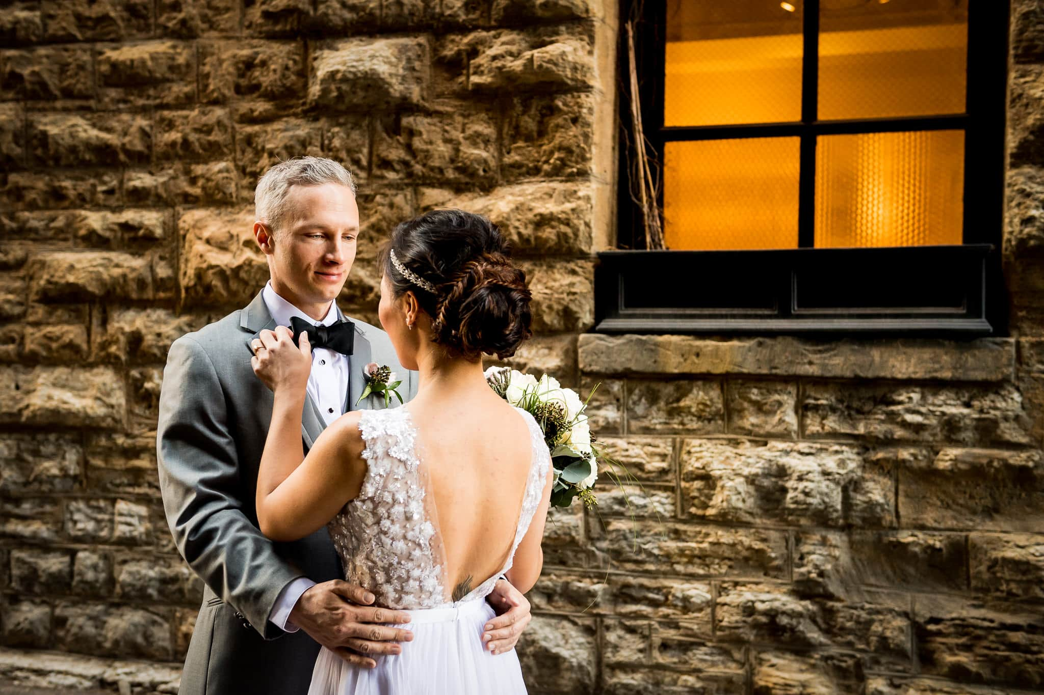 Bride and Groom share an intimate moment in the alley behind the Hewing Hotel
