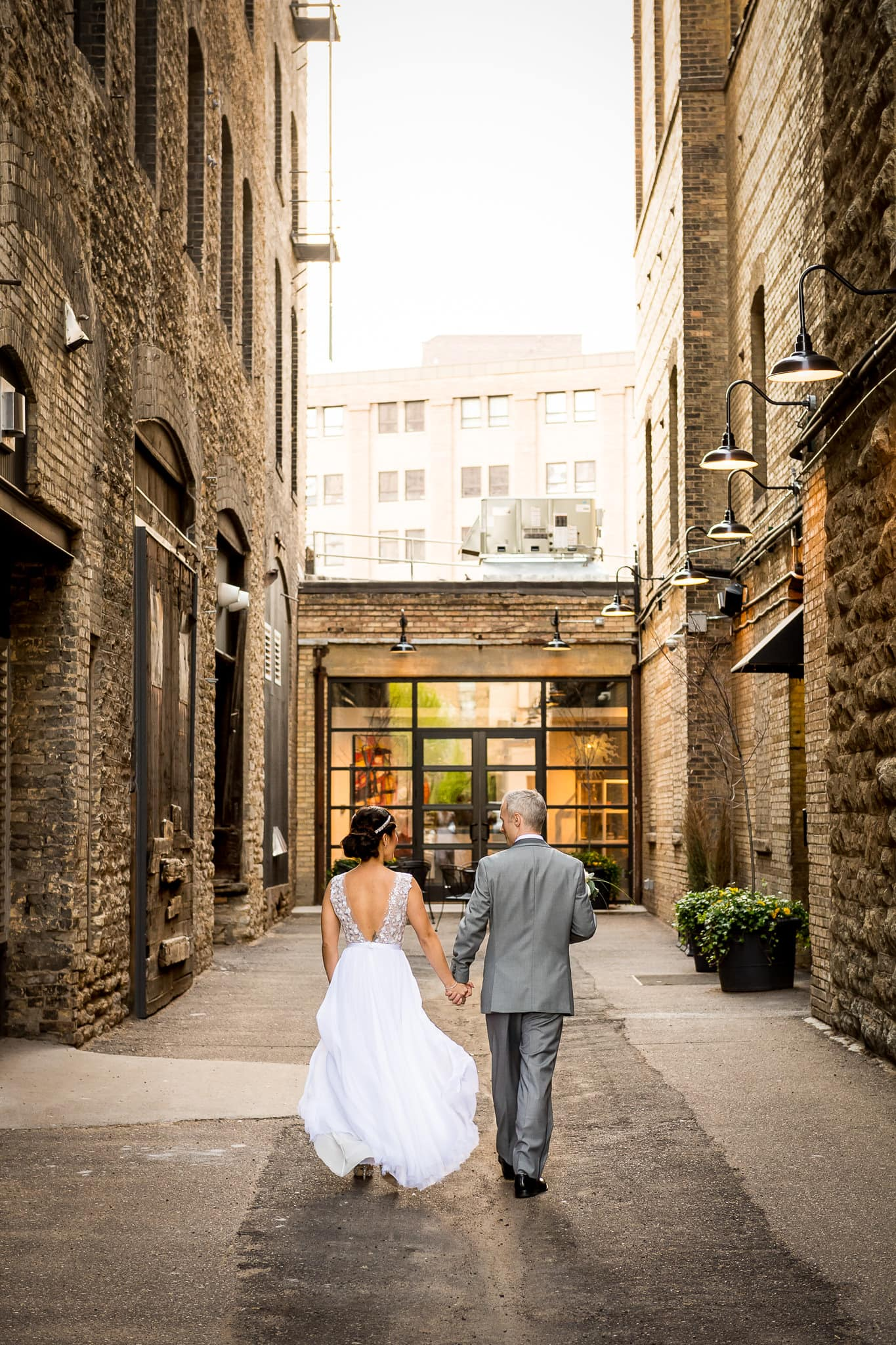 Wedding couple walking in the alley at the Hewing Hotel