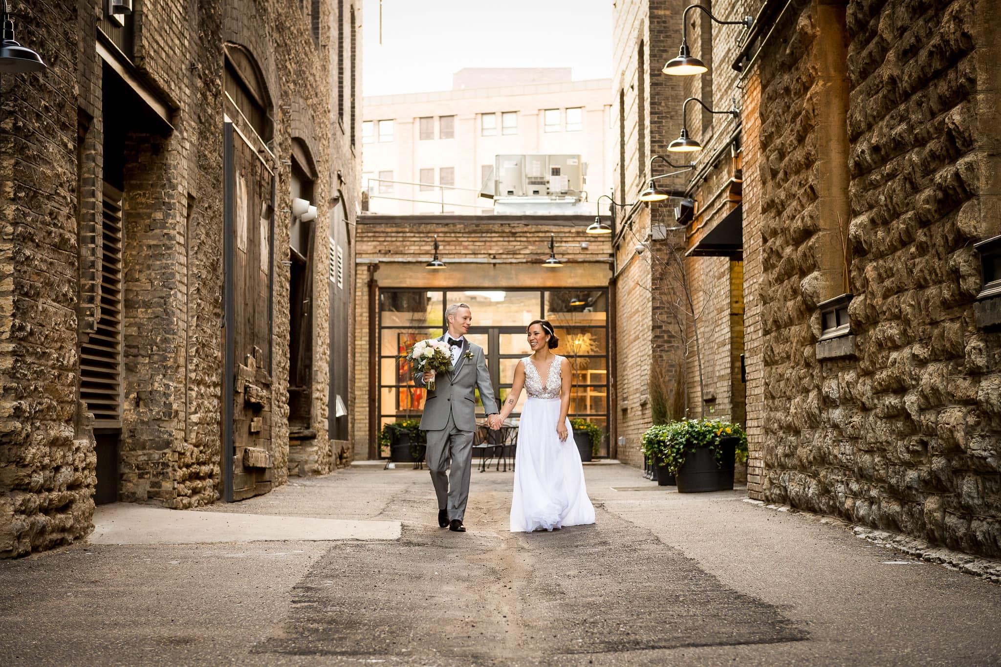 Bride and Groom Walking together at the Hewing Hotel